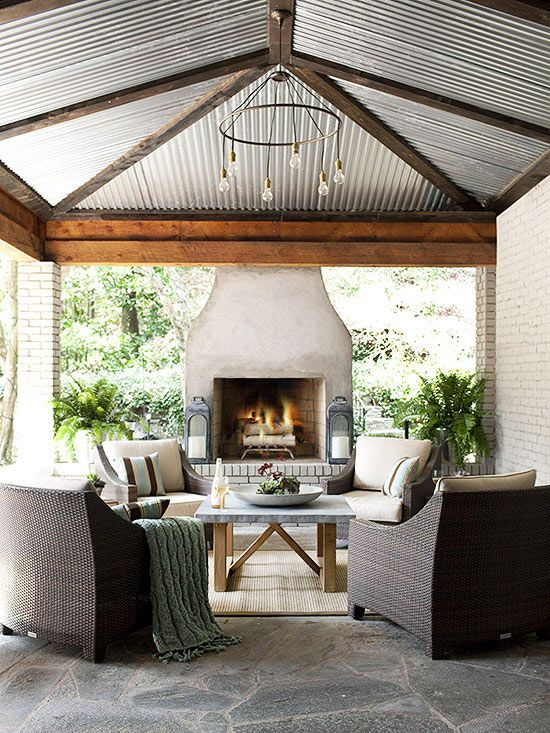 I just love this ceiling! Imagine enjoying a fire while it rains on that tin ceiling! LOVE.
