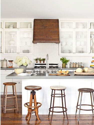 I love this all white kitchen and wooden vent hood!